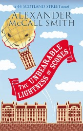 Cover of The Unbearable Lightness of Scones. Hot-air balloon, banner with title and a street with houses with 4 storeys.